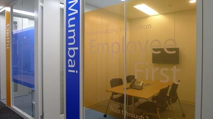 HCL JAPAN LTD./【Meeting room】The graphics are designed with the four corporate philosophies, including Employees First, etc.