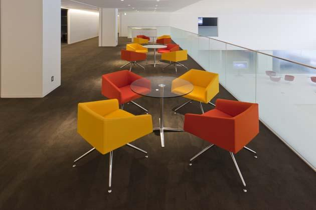 Tokyo Electron Miyagi Limited/【Open meeting space for guests】This is a space characterized by its colorful colors and designed taking into account how it looks from the entrance.